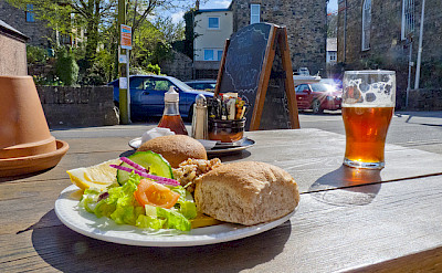 Fresh crab sandwich and some beer in Pembrokeshire. Photo via Flickr:Dave Collier