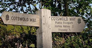Signs lead the way through the Cotswold Hills. Photo via Flickr:Richard Cocks