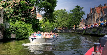 A boat ride in Bruges. Photo via Flickr:Wolfgang Staudt