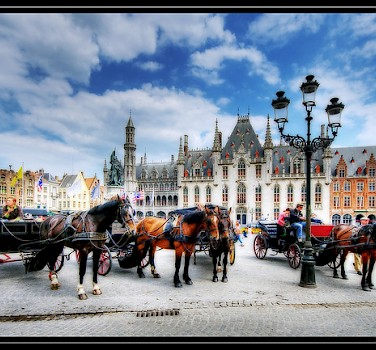 The large square in Bruges, where you can take a horse-drawn carriage ride through the small town. Photo via Flickr:Wolfgang Staudt