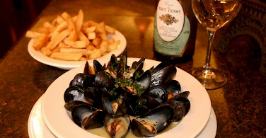 Moules frites aka mussels with fries, very common in Belgium. Photo via Flickr:NwongPR