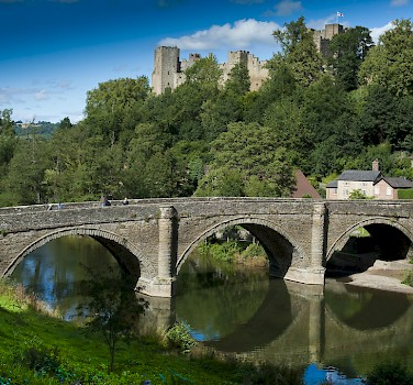 Biking over Dinham Bridge, Ludlow, Shropshire, England. Photo via flickr: Shropreshire&Telford TSB