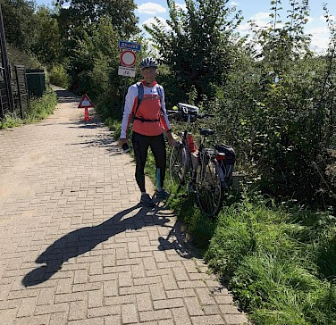 Hennie biking from Rhenen to Wageningen in the Netherlands.