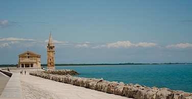 Cycling the coast in Caorle, Italy. Photo via Flickr:iesse