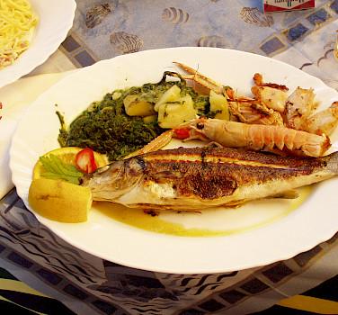 Seafood lunch in Piran, Slovenia. Photo via Flickr:Toni Krasnic