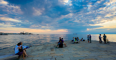 Relaxing on the coast of Trieste, Italy. Photo via Flickr:Nick Savchenko
