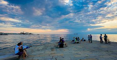 Relaxing on the coast of Trieste, Italy. Photo via Flickr:Nick Savchenko