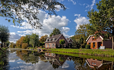 Biking along the canals in the Netherlands. ©Hollandfotograaf