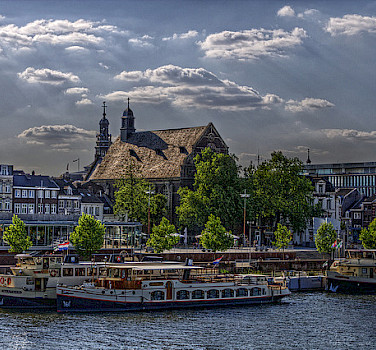 The gorgeous city of Maastricht on the Maas River on your 3 Country Bicycle Tour. Photo via Flickr:Peter Koves