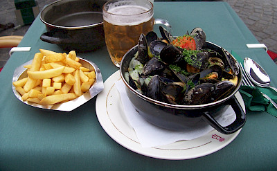 Moules frite (mussels & fries) with beer in Belgium. Flickr:Colin Cameron