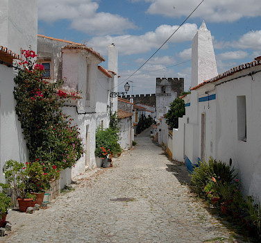 "Cobbled street in the ""white gold"" city of Estremoz, Alentejo, Portugal. Photo courtesy of Tour Operator."