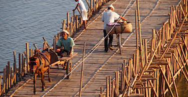 Bamboo bridge in Kompong Cham, Cambodia. Photo via Flickr:paularps