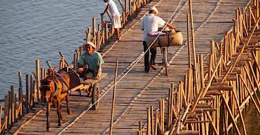 Bamboo bridge in Kompong Cham, Cambodia. Photo via Flickr:paularps