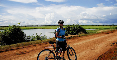 Biking in Cambodia. Photo via Flickr:xtinalicious