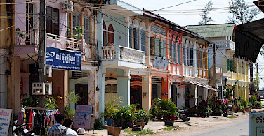 French colonial architecture in Kampot, a small river town in Cambodia. Photo via Flickr:HeyItsWilliam