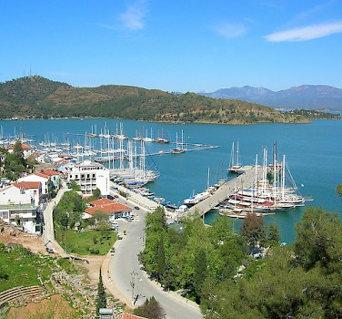 Boats in harbor in Fethiye, Turkey. Photo via Flickr:Kcsarioglu