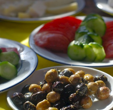 Typical Turkish breakfast with olives, yogurt, cucumbers, tomatoes and cheese. Photo via Flickr:AlphaTangoBravo/Adam Baker