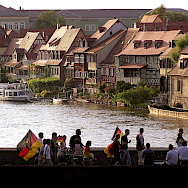 Soccer fans heading home past Bamberg's Little Venice. Flickr:Qole Pejorian