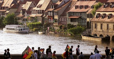 Soccer fans heading home past Bamberg's Little Venice. Photo via Flickr:Qole Pejorian