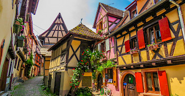 Decorative Eguisheim is known for its great Alsace wine. Photo via Flickr:Keifer