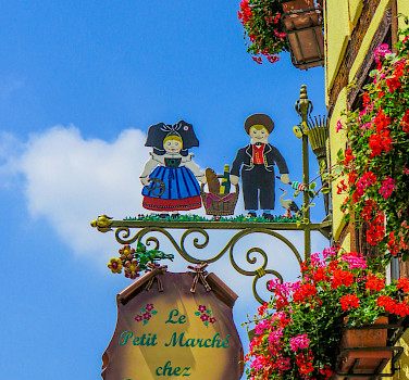 Signs mark the way in Eguisheim, Alsace, France. Photo via Flickr:Kiefer