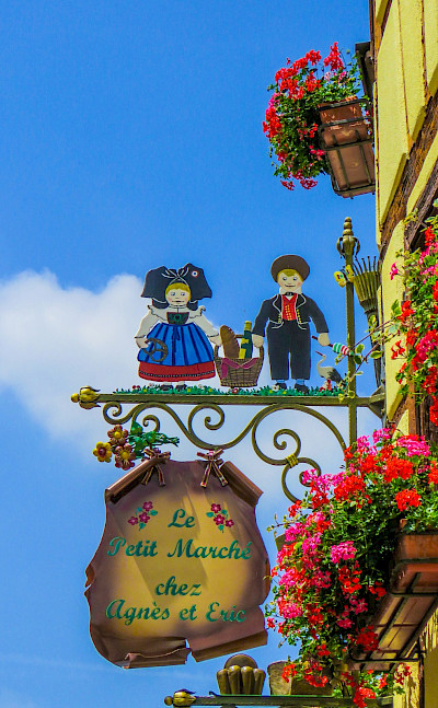 Signs mark the way in Eguisheim, Alsace, France. Flickr:Kiefer