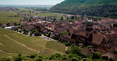 Vine-covered hills surround Kaysersberg, Alsace, France. Photo via Flickr:Allan Harris