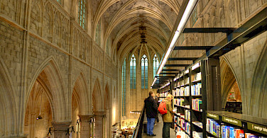 Church turned bookstore in Maastricht, Limburg, the Netherlands. Photo via Flickr:Bert Kaufmann
