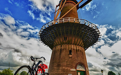 Bicycles and windmills are Holland's specialty. Photo via Flickr:Luca Bolatti Guzzo