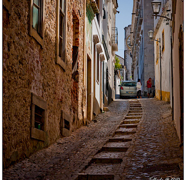 Street in Tavira, Algarve, Portugal. Photo via Flickr:tolbxela