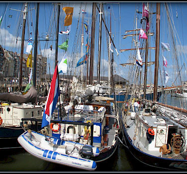 Ships in harbor in Ostende (also Oostende), West Flanders, Belgium. Photo via Flickr:sophie