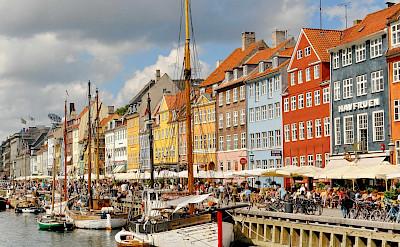 """Biking through Nyhavn or """"New Harbor"""" in Copenhagen, Denmark. Flickr:Dimitris Karagiorgos"""