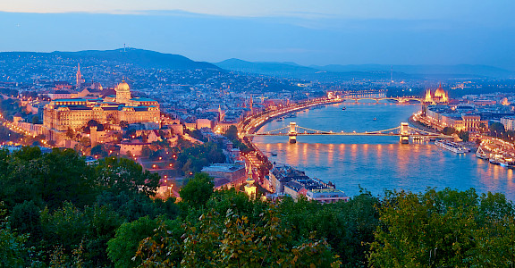 Budapest on the Danube River with Buda Castle on the left and Hungarian Parliament on the right. Photo via Flickr:Moyan Brenn