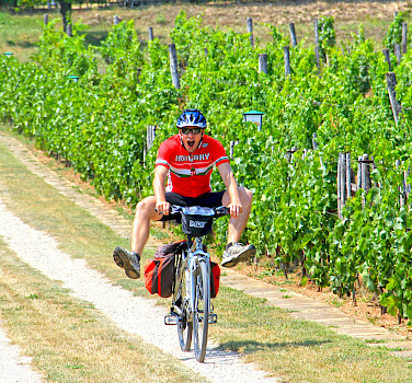 Enjoying the ride on the Lake Balaton Bike Tour in Hungary.