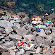 Sunbathing in Acireale, Sicily, Italy. Flickr:Photocapy