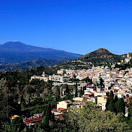 View of Taormina and Mt Etna from ancient theatre in Sicily, Italy. Wikimedia Commons:John Menard