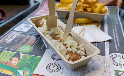 Traditional Dutch treat - frikandel with fries. Flickr:Marco Verch