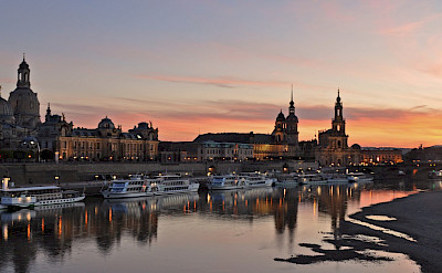 Boats at sunset on the Elbe River in Dresden, Germany. Flickr:Harshil Shah