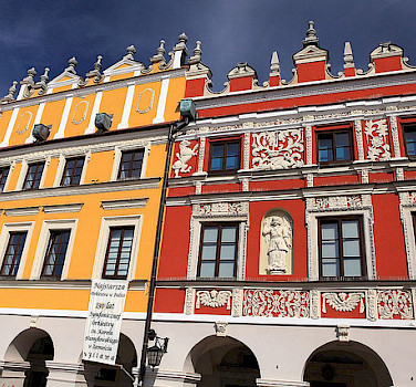 Gorgeous colorful buildings in Zamosc. Photo via Flickr:PolandMFA
