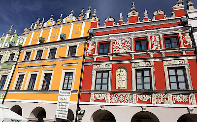 Gorgeous colorful buildings in Zamosc. Photo via Flickr:PolandMFA