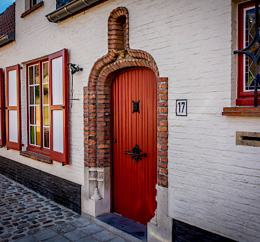Cobbled street in Bruges, Belgium. Photo via Flickr:Ron Kroetz