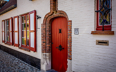 Cobbled street in Bruges, Belgium. Flickr:Ron Kroetz