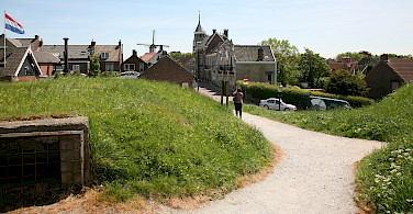 Cycling through Willemstad, North Brabant, the Netherlands. Photo via Flickr:Bert Knottenbeld