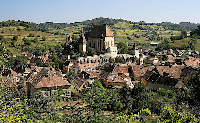 View of the fortified church in the village of Biertan, Romania. Photo via Flickr:Guillaume Baviere