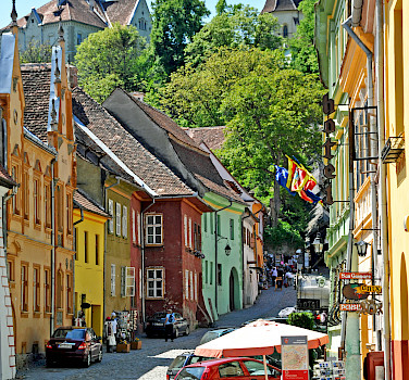 Street in Sighisoara, Transylvania, Romania. Photo via Flickr:Dennis Jarvis