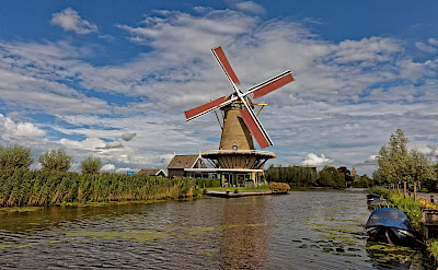 Many canals and windmills in the Netherlands. ©Hollandfotograaf