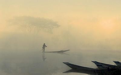 Boat at sunrise near Nyaungshwe, Burma. Photo by Tim Manning