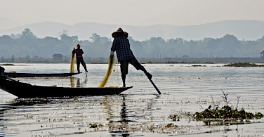 Fisherman on stilts in Inle Lake, Myanmar. Photo by Tim Manning