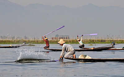 Slapping water on Inle Lake in Burma. Photo by Tim Manning