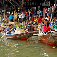 Rowing ladies at Damnoen Saduak Floating Market near Bangkok, Thailand. Photo via Flickr:Dennis Jarvis